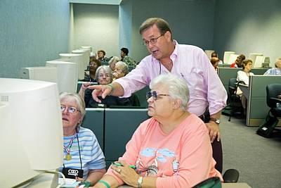 Senior Citizens Learning To Use Computers Print by Jim West