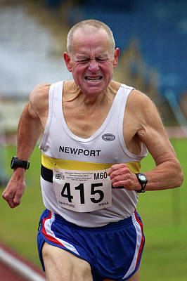 Sixty Photograph - Senior Male Athlete Runs Through The Pain by Alex Rotas