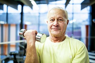 Self-confidence Wall Art - Photograph - Senior Man Holding Dumbbell by Science Photo Library