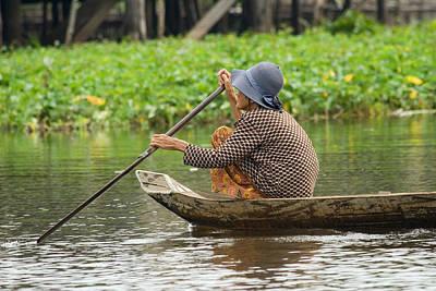 Senior Woman Paddling A Boat Art Print