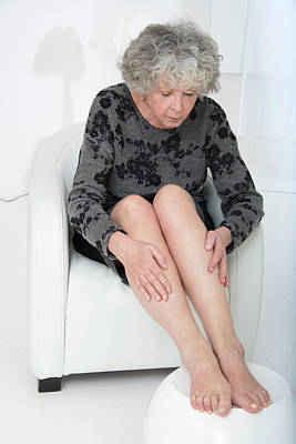 Senior Woman Touching Her Legs Art Print