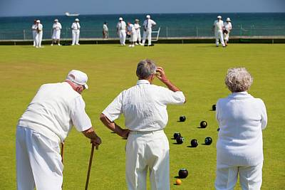 Gathering Photograph - Seniors Playing Bowls At Penzance by Ashley Cooper