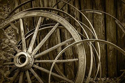 Wagon Wheel Hub Wall Art - Photograph - Sepia Photo Of Broken Wagon Wheel And Rims by Randall Nyhof