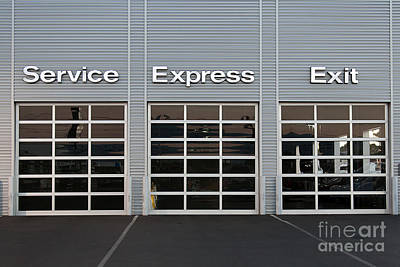 Photograph - Service Station At Car Dealership by Gunter Nezhoda