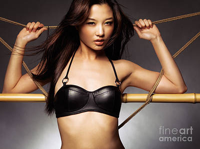 Sexy Asian Woman In Black Leather Bra Leaning Against Ropes Art Print by Oleksiy Maksymenko