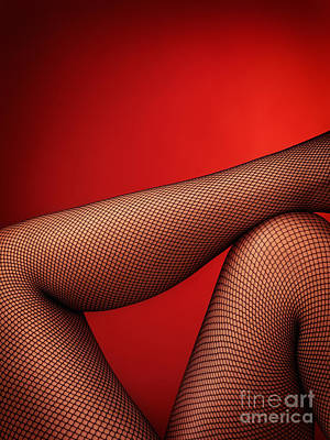 Suggestive Photograph - Sexy Woman Legs In Fishnet Stockings On Red by Oleksiy Maksymenko
