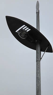 Photograph - Shield And Spear Street Lamp    by Frank Chipasula
