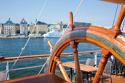 Photograph - Ship Helm And A View On Stockholm by Michal Bednarek