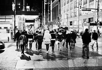 Crosswalk Photograph - shoppers crossing corner of granville and west georgia streets at night Vancouver BC Canada by Joe Fox