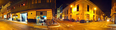Shops Along A Street At Night, Lima Art Print by Panoramic Images