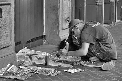 Photograph - Sidewalk Artist In Black And White by Nadalyn Larsen