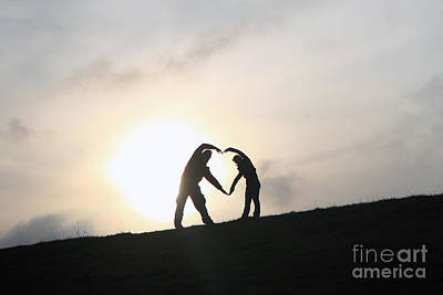 Silhouette Couple Forming A Heart Art Print by Lars Ruecker