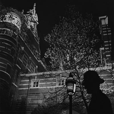 Candid Photograph - Silhouette Of A British Policeman At Night by Roger Schall