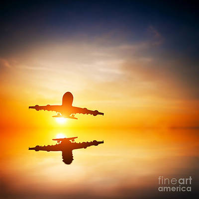 Passenger Plane Photograph - Silhouette Of A Flying Passenger  by Michal Bednarek
