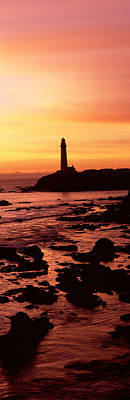 Silhouette Of A Lighthouse At Sunset Art Print