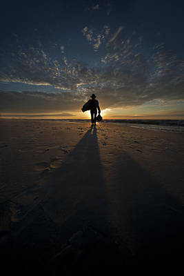 Photograph - Silhouette Of A Man Wearing Hat And The Bag In Hand Walking On The Seashore by Jaroslaw Blaminsky