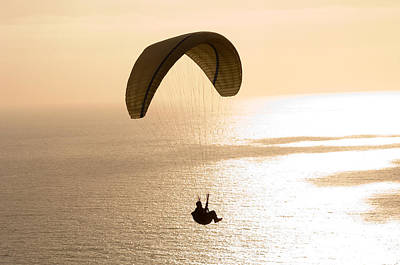 Silhouette Of A Paraglider Flying Art Print