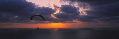 Silhouette Of A Person Paragliding Art Print by Panoramic Images