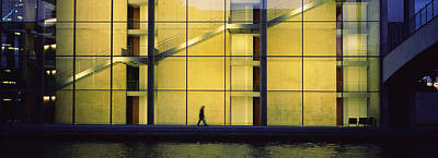 Silhouette Of A Person Walking In Front Art Print by Panoramic Images