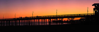 Clear Sky Photograph - Silhouette Of A Pier At Sunset by Panoramic Images