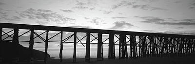 Yellow And Pink Sunset Photograph - Silhouette Of A Railway Bridge, Fort by Panoramic Images