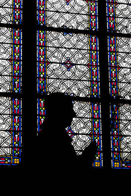 Photograph - Silhouette Of A Statue In Front Of A Colorful Window In A Chatedr by Francesco Rizzato