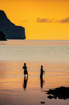 Silhouette Of Boys Fishing At Sunset Art Print