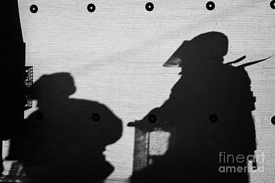 Terrorist Photograph - Silhouette Of British Army Soldiers On Screen On Crumlin Road At Ardoyne Shops Belfast 12th July by Joe Fox