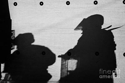 Silhouette Of British Army Soldiers On Screen On Crumlin Road At Ardoyne Shops Belfast 12th July Art Print by Joe Fox