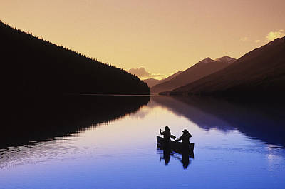 Silhouette Of Canoeists, Bowron Lake Print by Chris Harris