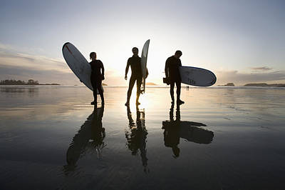 Silhouette Of Three Surfers Carrying Art Print