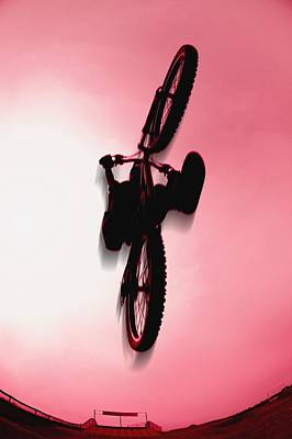 Silhouette Stunt Bike Rider Print by Corey Hochachka