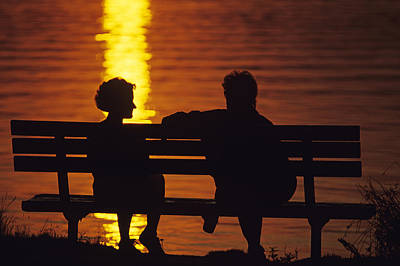 Silhouetted Couple On Park Bench.tif Art Print by Jim Corwin