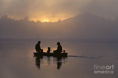 Photograph - Silhouetted Family In Small Boat by Jim Corwin