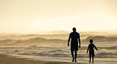 Silhouetted Father And Son Walk Beach  Art Print