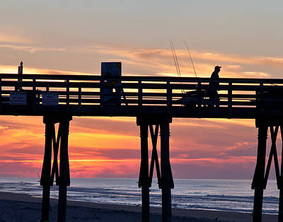 Silhouetted Fisherman On Ocean Pier At Sunrise Art Print