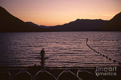 Balance In Life Photograph - Silhouetted Man Lake Wenatchee by Jim Corwin