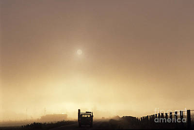Photograph - Silhouetted Truck Along Rural Highway At Sunrise In Fog  by Jim Corwin