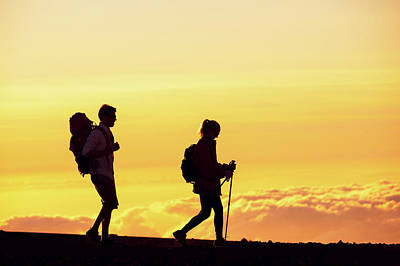 Silhouettes Of Two Hikers Art Print by Design Pics Vibe