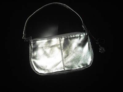 Silver Bag With Rose Locket Art Print by Robert Cunningham