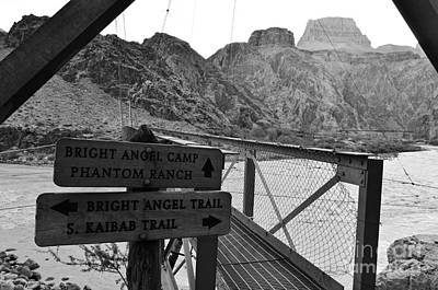 Photograph - Silver Bridge Signs Over Colorado River At Bottom Of Grand Canyon National Park Black And White by Shawn O'Brien