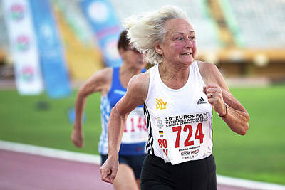 Aging Photograph - Silver-haired Female Athlete Running by Alex Rotas