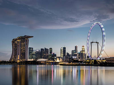 Architecture Photograph - Singapore Skyline At Dusk by Martin Puddy