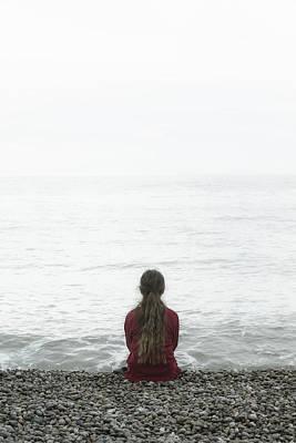 Thoughtful Photograph - Sitting On Pebble Beach by Joana Kruse
