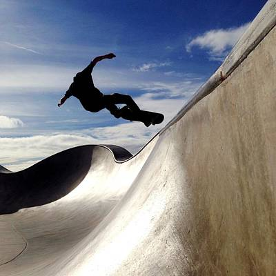 Photograph - Skater Jumping In Skateboard Park by Alongoldsmith
