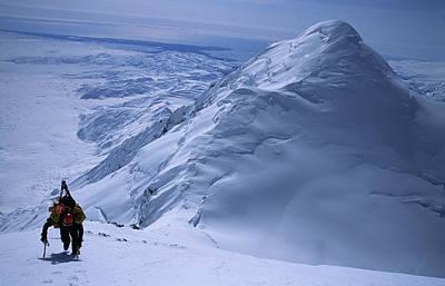 Skier Hikes Up Snowy Mountainside Art Print