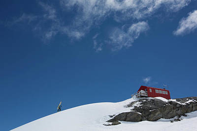 Ski House Wall Art - Photograph - Skier Hiking Up Snowy Mountain To Small by Adam Clark