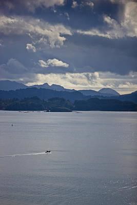 Alaska Photograph - Skiff Off The Shore Of Kodiak Island by Kevin Smith