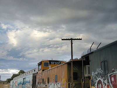Photograph - Sky Clouds And Graffiti Old Santa Fe Railyard by Kathleen Grace