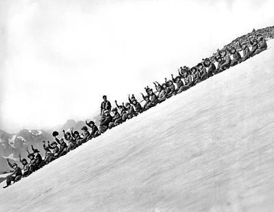 Sliding Down Mt. Rainier Art Print by Underwood Archives